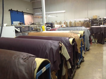 To come up with our ratings, we often tour manufacturing facilities. Here's a shot from Dutailier's factory in Saint-Hyacinthe, Quebec, Canada. Those are leather pelts about to be cut by a water jets, on the way to becoming a glider rocker in your nursery. Yes, water jets!
