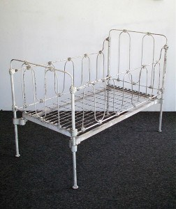 Here's an antique iron baby crib, like many cribs lurking in relative's basements and attics. Does it meet current safety standards. That would be a big fat NO!