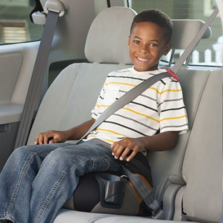 Kid in backless car seat