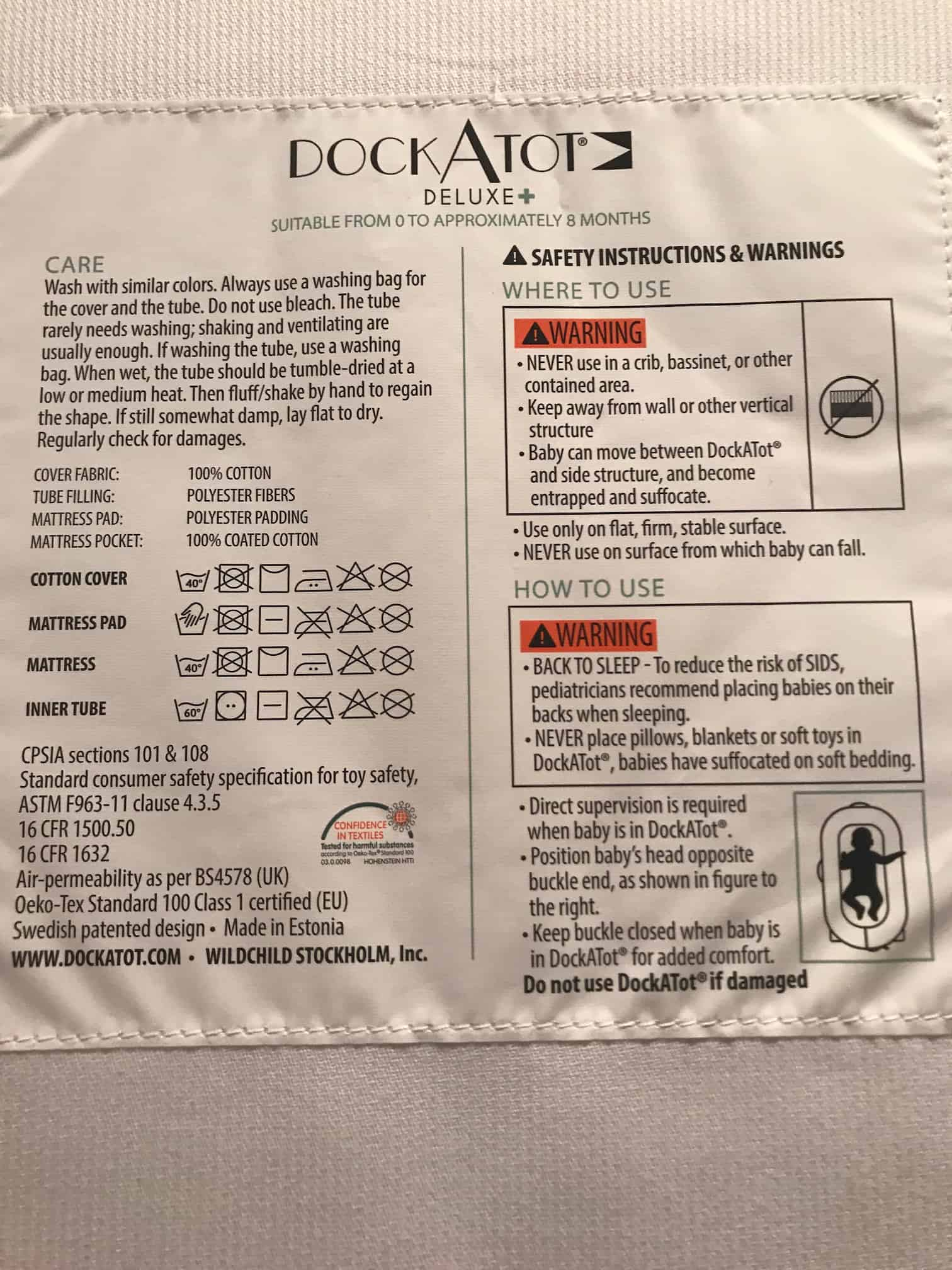 DockATot's usage and safety instructions are sewn to the back of the pillow.